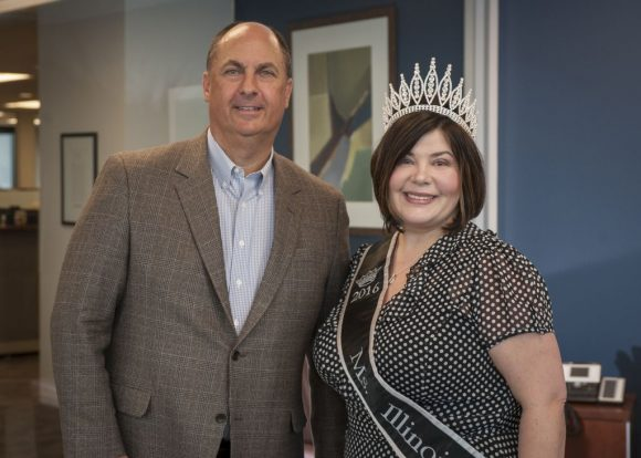 Wendy Roach, Miss Illinois Plus America and director of patient access at Advocate Good Shepherd Hospital in Barrington, poses with Advocate President and CEO Jim Skogsbergh.